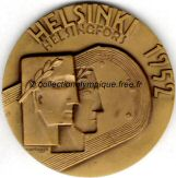 1952_helsinki_olympic_participant_medal_verso.jpg