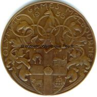 1956_melbourne_olympic_participant_medal_verso.jpg